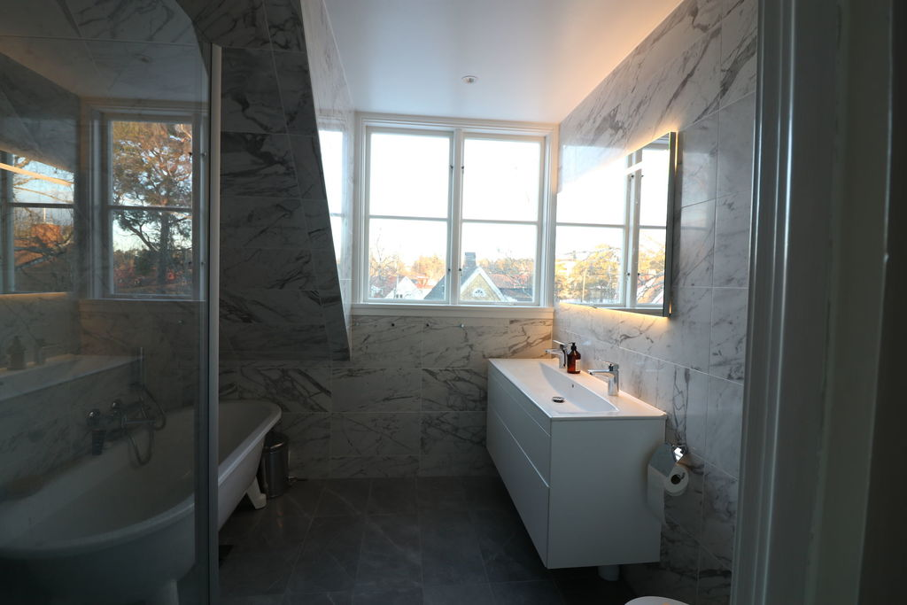 Newly renovated main bathroom with shower and bath