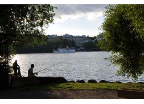 Steam ship and fishing in central Stockholm