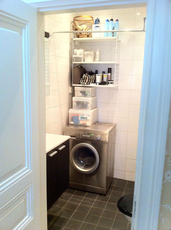 WC with washing machine/dryer and shower.