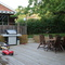 Large deck with seating area, barbeque, etc.