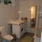 Bathroom with bathtub and washer/dryer