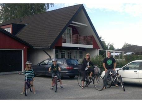 In front of the house, ready for a bike-ride