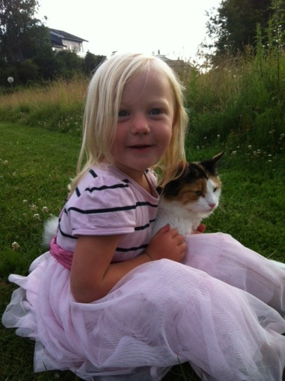 Our daughter Ebba with our lovely cat Ella. The cat will not be in the house during your stay unless you want it to.
