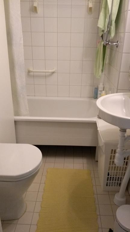 The bathroom is tiny, but has a bath tub.