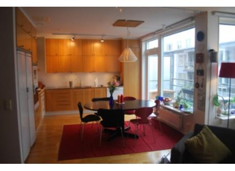 The kitchen with access to the balcony with view of lake Mälaren