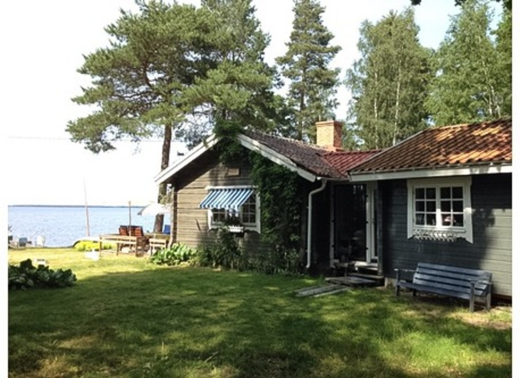 Summer cottage with our private beach in front of the house.