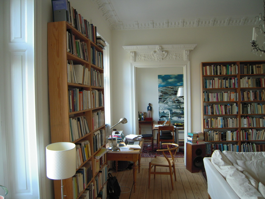 Living room facing dining room - thousands of books in different languages