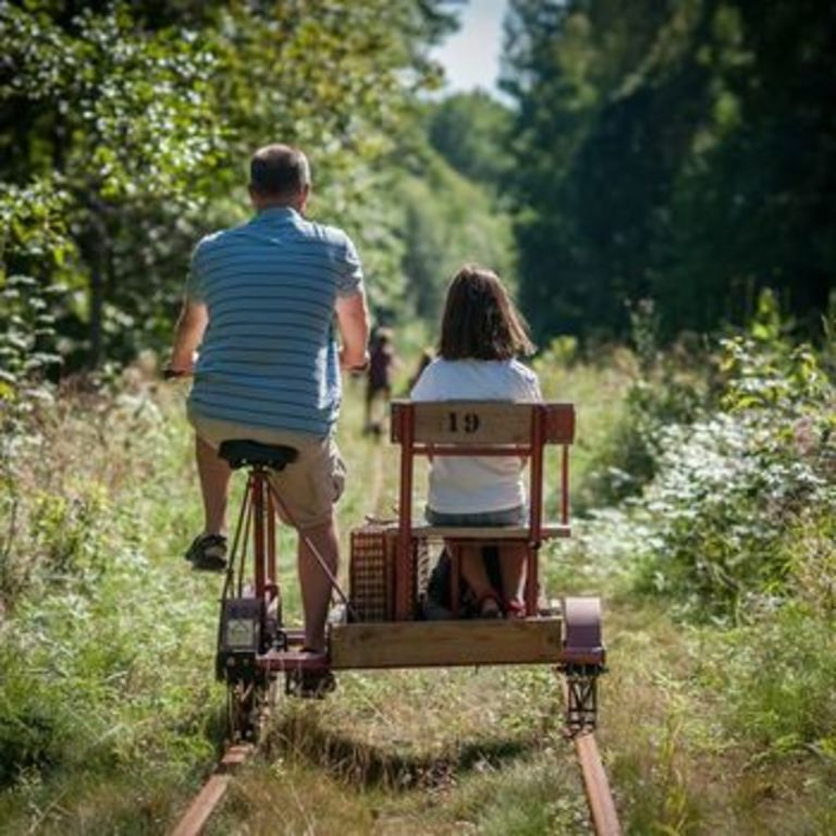 Handycar on an old railway track with possiblity to stop for a swim.