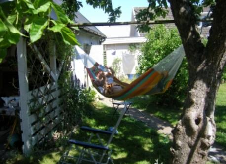 The hammock underneath the apple tree, in the backside of our garden