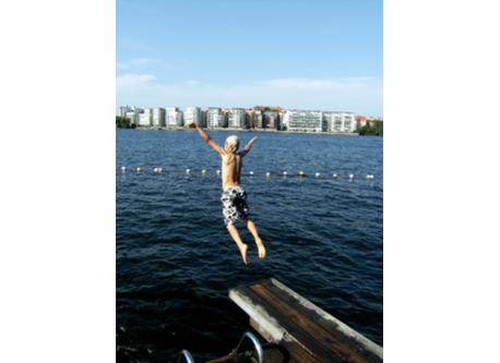 Our son jumping into Lake Mälaren