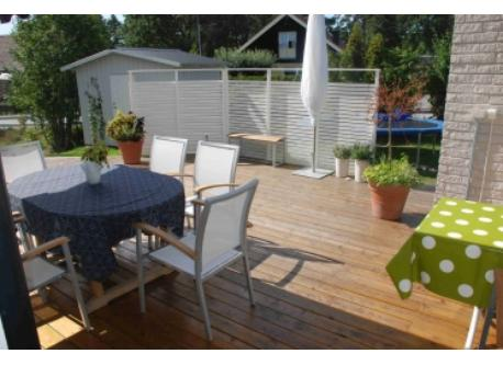 Wooden deck facing south/west, accessible from the kitchen