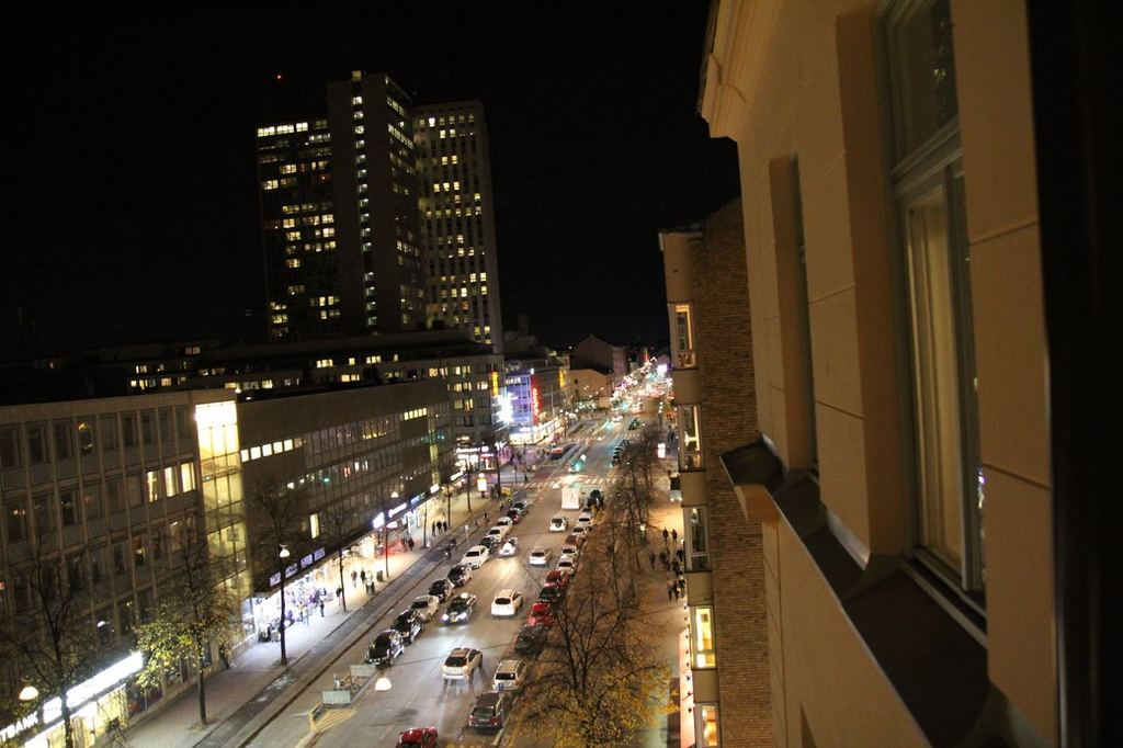 Night shot from one of the windows. In the tall building there is a shopping center.