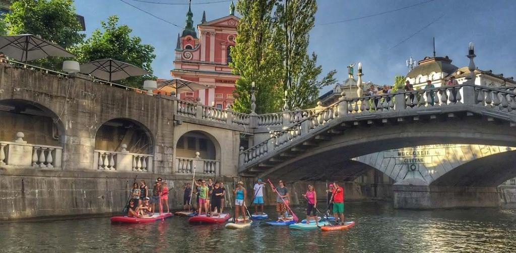 SUP tour on Ljubljanica river to explore the green city of Ljubljana from a different perspective.
