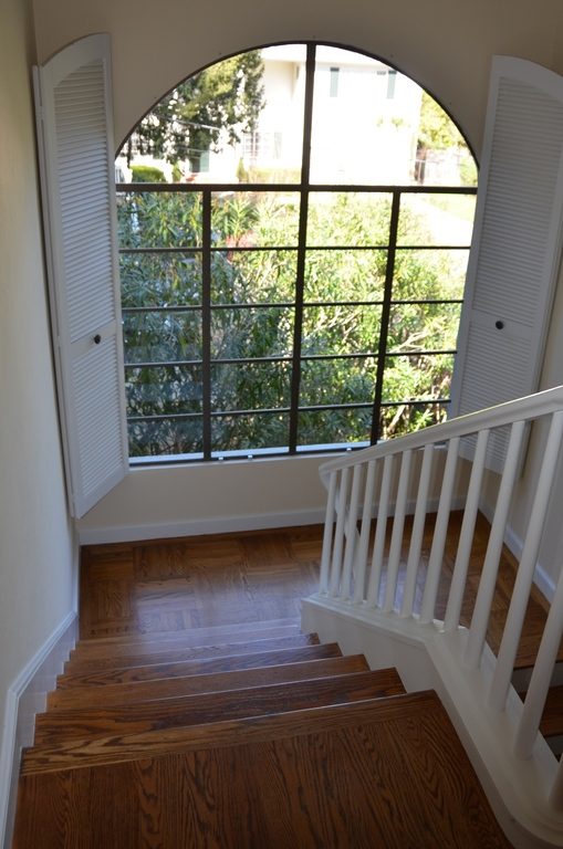 Stairs from 2nd floor (bedrooms) to main living area; View of cul-de-sac.