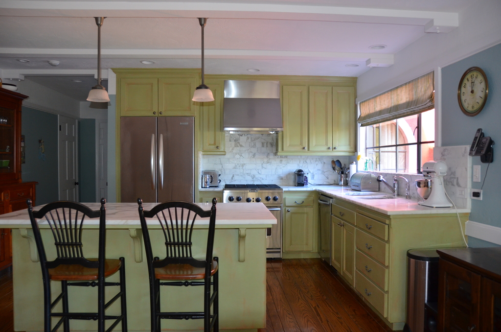 Kitchen with modern appliances; connected to family room; access to deck with gas grill.