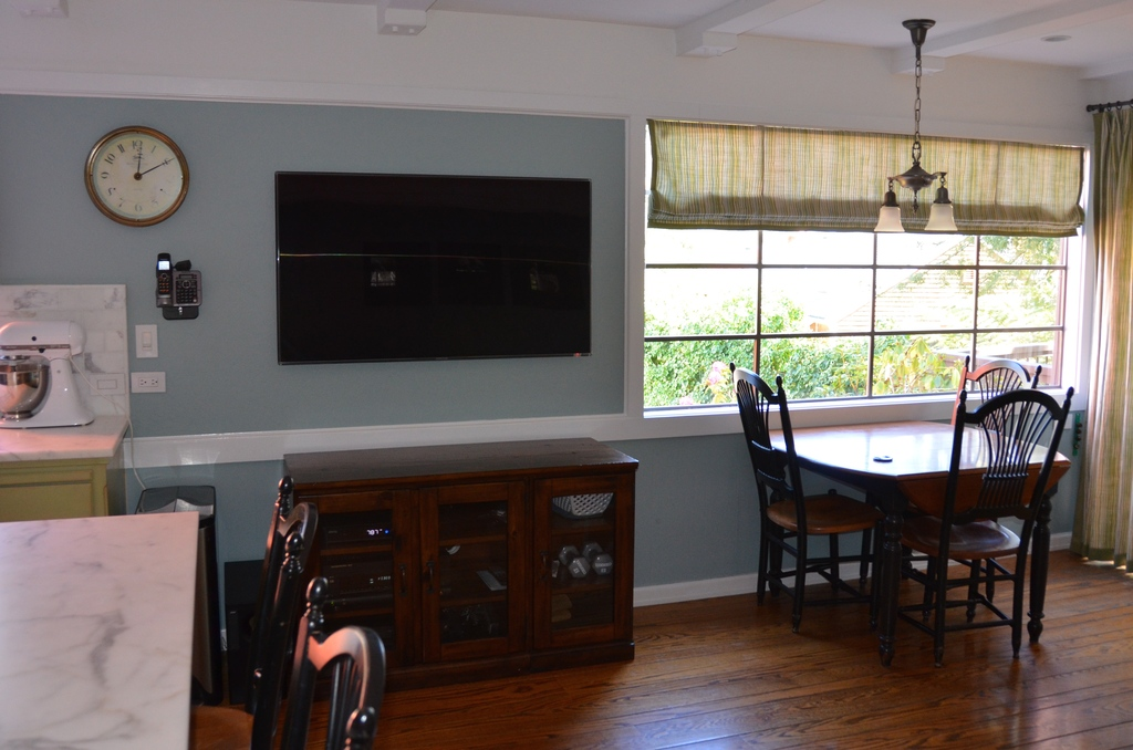 Another view of family room/kitchen; 55 inch flat screen TV with cable/DVR/VHS/DVD.