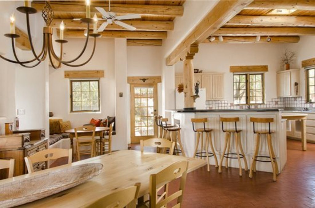 Great Room with view of large dining table, breakfast nook and kitchen