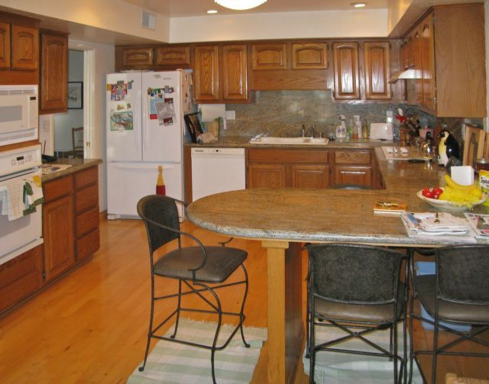 Kitchen with electric range, dishwasher, convection and microwave ovens