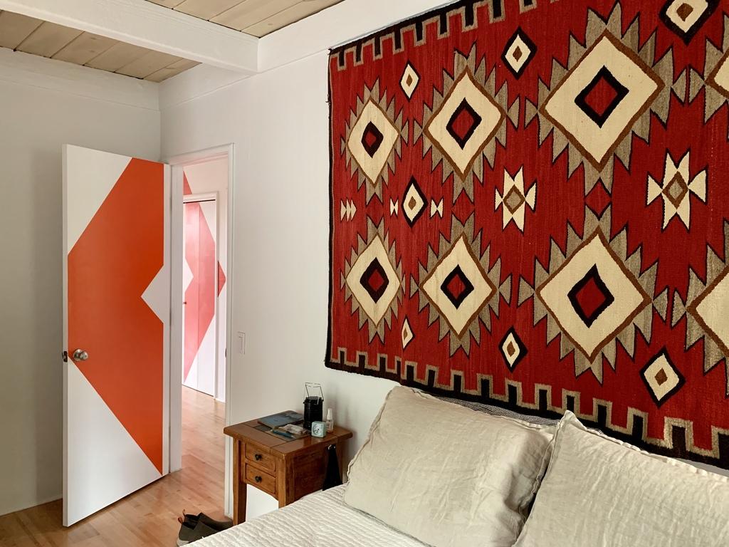 Main bedroom with door to hallway mural