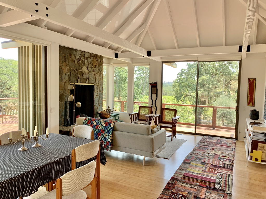 The great room of the house combines Living, Dining, and Kitchen areas, with wonderful views