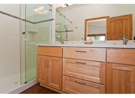 All baths are ensuite, bright and clean with tile and concrete countertops.