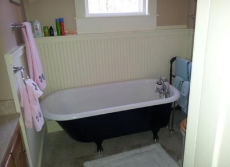 Upstairs bath with clawfoot tub, serves master bedroom and 3 small 2nd floor guest bedrooms.