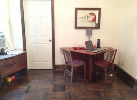 table in living room, door to office/bedroom