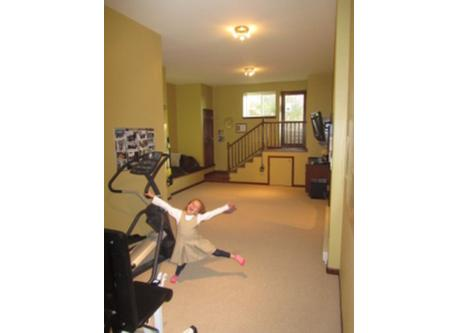 2nd TV viewing area and workout room with elliptical, TRX and free weights.
