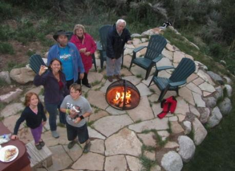 Family gathering around our firepit, which is next to the hot tub.