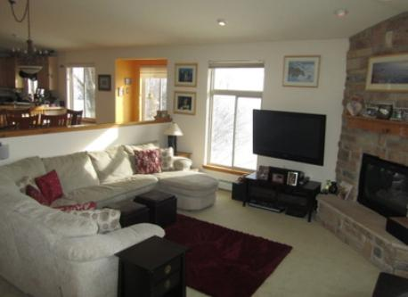 """our bright and sunny living room with 50"""" TV and fireplace"""
