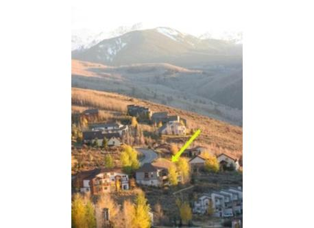 view of our home from the hills above in the Fall