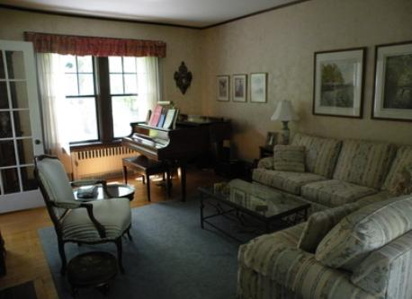 "Living room with grand piano in ""old house"""