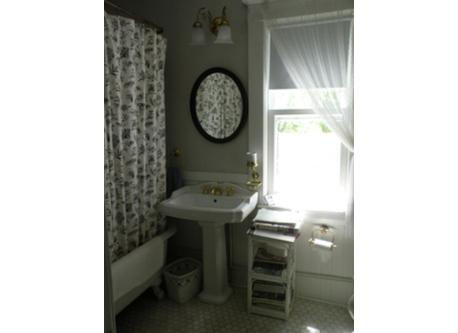 "Bathroom serving ""old house"" guest bedroom and den"