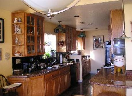 Kitchen area of Great Room with granite countertops, gas stove & electric oven, all major appliances.
