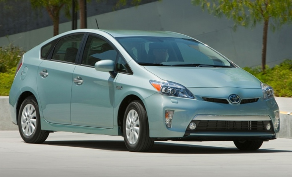 Our Prius will comfortably seat four adults or a (loving) family of 5