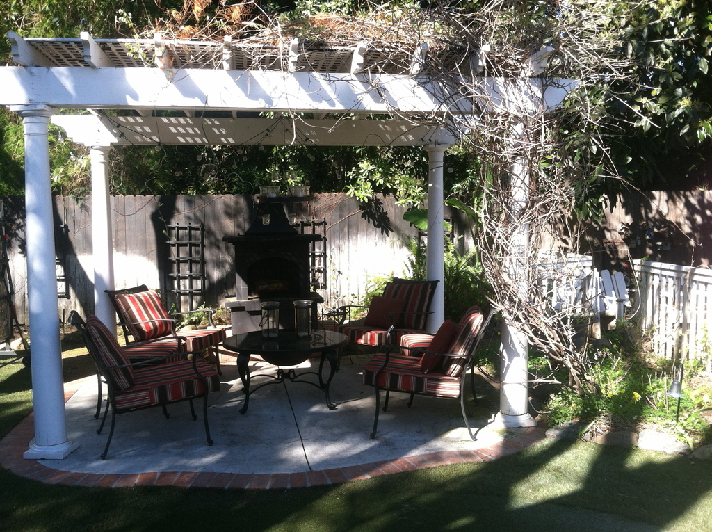 Outdoor pergola with fireplace