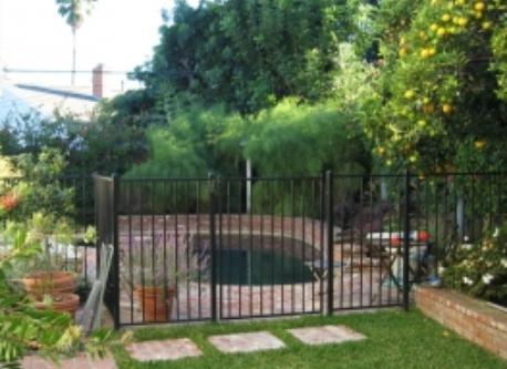 Fenced, black-bottom pool