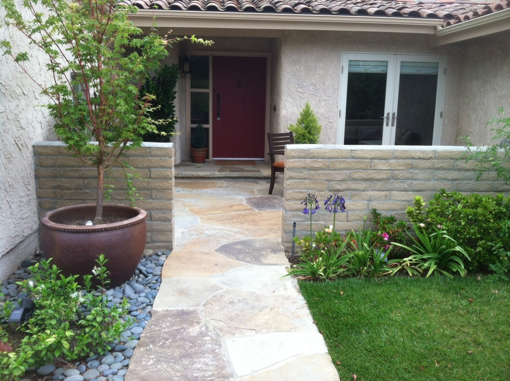 Front entrance and walled flagstone patio area