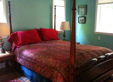 Apartment bedroom with queen bed