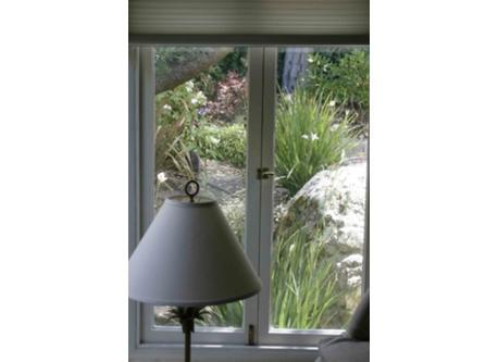View of garden through bedroom window