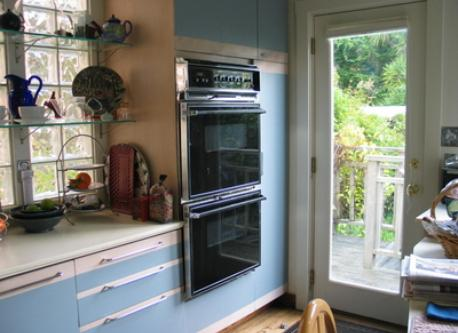 Kitchen with double ovens, door to garden