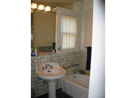 Full bath on second floor near bedrooms, tub and walk in shower