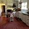 blurry view of kitchen -(daughter reading!) doorway to dining room and front door