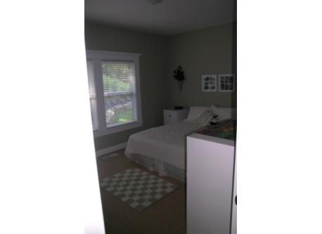 Guest bedroom with attached bathroom and large walk in closet