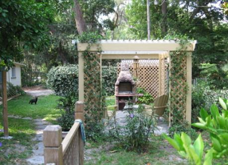 Pergola with fireplace in rear yard