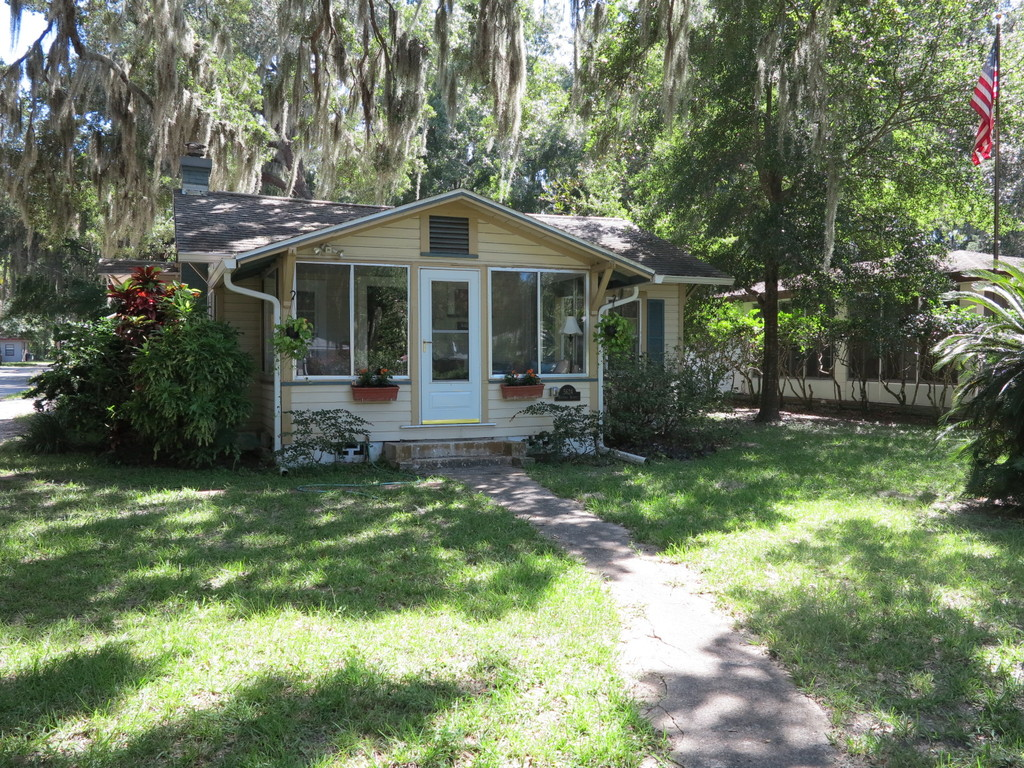 Located under large, shady live oak trees with Spanish moss.