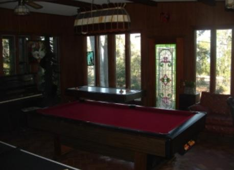 Game room with pool table, table tennis, and air hockey.