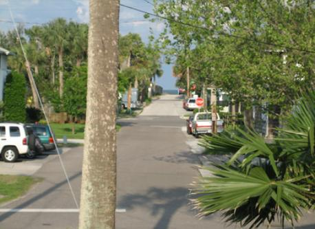 view up the street to ocean from my front porch