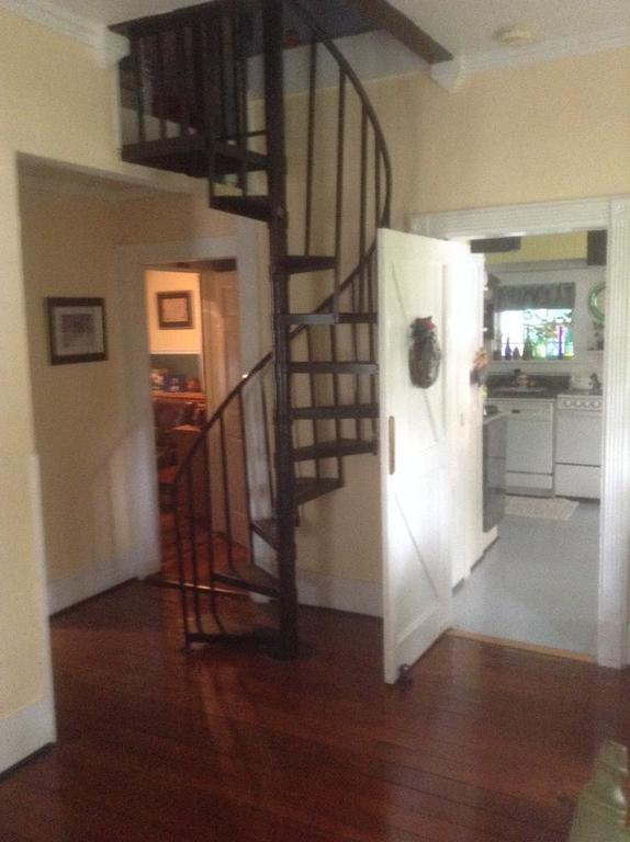 Photo from the living room showing the stairs to 2 beds and a 1/2 bath.  The kitchen and office are in the background.