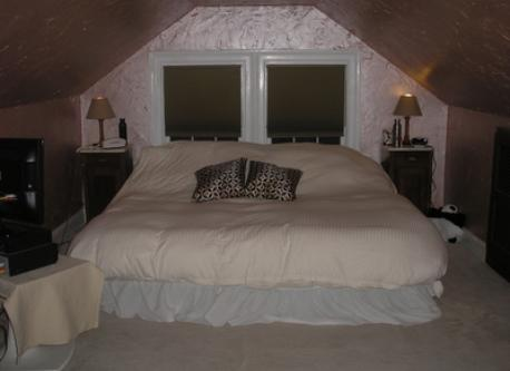 This is the master bedroom...there is a HD TV with satellite.  There is a king-sized mattress and lots of soft down pillows.